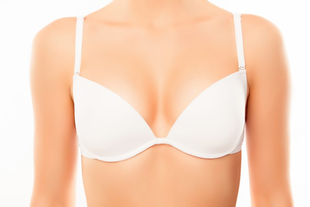 Close up of woman chest in white bra